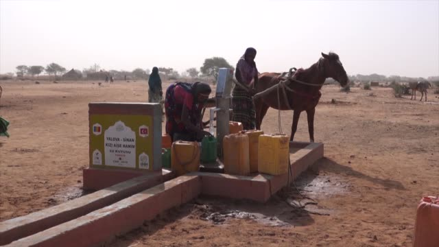 turkey's humanitarian relief foundation has so far opened 6,747 water wells in 36 countries under the scope of its 18-year-long project. in a... - charity and relief work stock videos & royalty-free footage