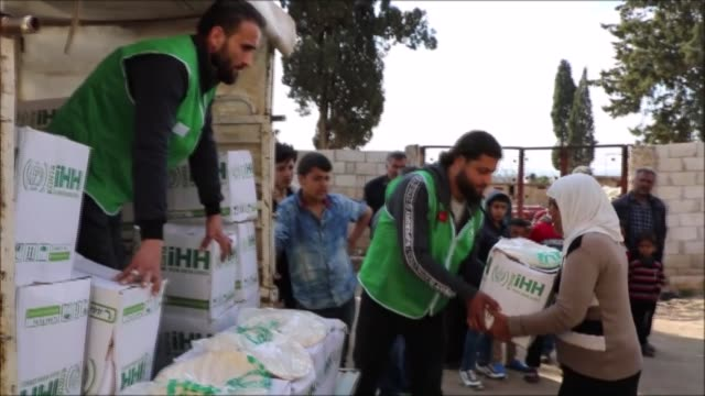 turkey's humanitarian relief foundation is sending aid to families in a village in afrin, syria in the wake of its liberation from terrorists during... - isil konflikt stock-videos und b-roll-filmmaterial