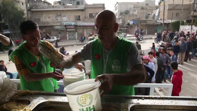 turkey's humanitarian relief foundation on friday began distributing hot meals to residents of afrin town center which was recently cleared of... - charity and relief work stock videos & royalty-free footage