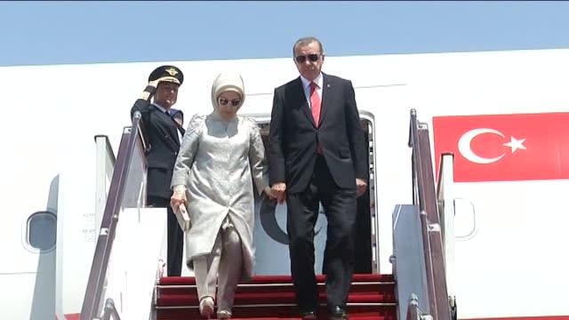 Turkey's President Recep Tayyip Erdogan and his wife Emine Erdogan arrive at the Heydar Aliyev International Airport in Baku where they came to...