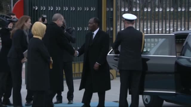 turkey's president recep tayyip erdogan welcomes ivory coast's president alassane ouattara during an official welcoming ceremony at presidential... - ankara stock-videos und b-roll-filmmaterial