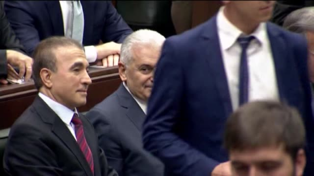turkey's prime minister and chairman of ruling justice and development party binali yildirim gives a speech during the parliamentary group meeting of... - トルコ首相点の映像素材/bロール