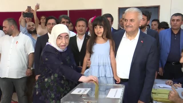 turkey's ruling justice and development party candidate binali yildirim and his wife semiha yildirim cast their ballots in istanbul mayoral election... - ballot box stock videos & royalty-free footage