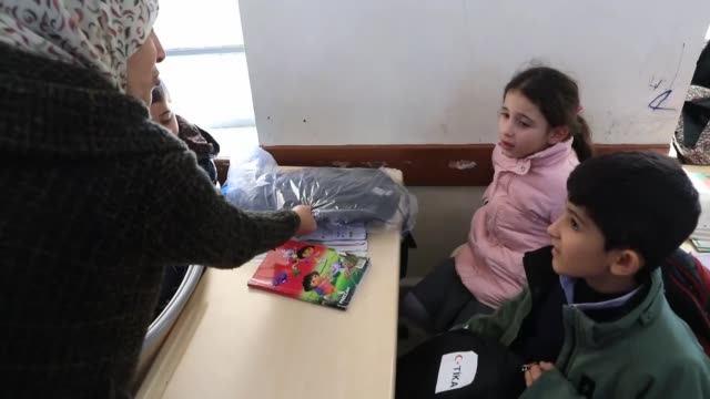 turkey's staterun aid agency distributed 1000 school bags and stationery supplies in iraq's erbil province on wednesday the distribution ceremony of... - stationary stock videos & royalty-free footage