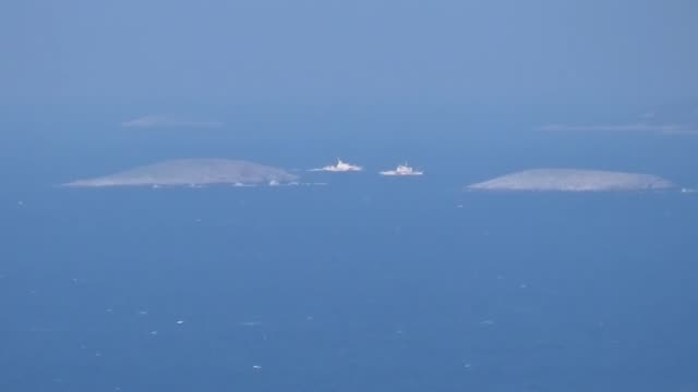 turkish and greek coast guard vessels patrol around the disputed uninhabited islets of kardak known as imia in greece in the aegean sea on the 21st... - mugla province stock videos and b-roll footage