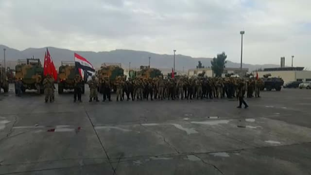 turkish and iraqi soldiers are advancing towards the habur border crossing which also is known as halil ibrahim with turkish and iraqi flags on... - silopi stock videos and b-roll footage
