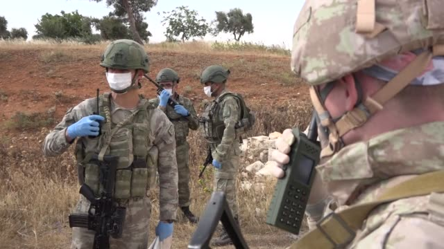 turkish and russian military elements have carried out their 15th joint patrol along a key highway in idlib, northwestern syria, near the turkish... - army soldier stock videos & royalty-free footage