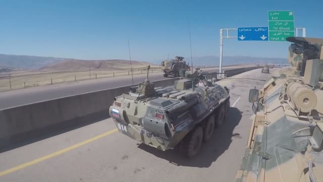 "turkish and russian troops hold their 22nd joint patrol along the key m4 highway in idlib, northwestern syria on july 22, 2020. ""according to the... - russia stock videos & royalty-free footage"