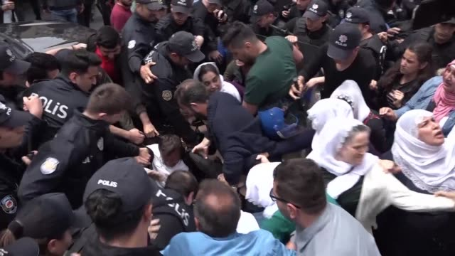 turkish antiriot police use their shields to push back dozens of female relatives of kurdish hunger strikers during an attempted protest in the... - conflict stock videos & royalty-free footage