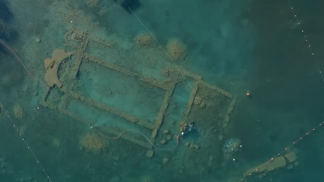 turkish archeologists are continuing underwater excavation works on a sunken basiliac at a depth of 1.5-2 meters, in a lake in turkey's northwestern... - underwater stock videos & royalty-free footage