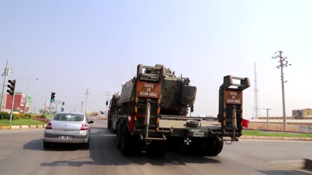 vídeos de stock e filmes b-roll de turkish armed forces are using locallymade vehicles weapons and ammunition including howitzers and drones in turkey's ongoing operation olive branch... - armamento