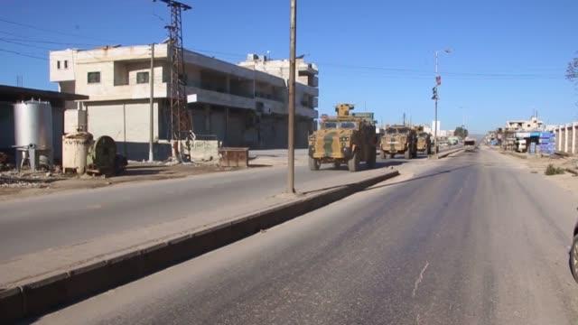 vídeos y material grabado en eventos de stock de turkish armed forces on friday started patrols in northwestern syrian city of idlib in the sochi summit held on feb 14 the guarantors countries... - sochi
