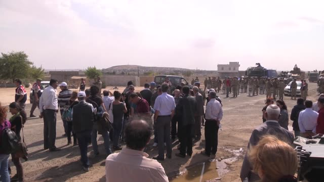 turkish armed forces tighten the security measures on the turkishsyrian borderline as isil attacks continue in the syrian border town of kobani also... - 軍用輸送車点の映像素材/bロール