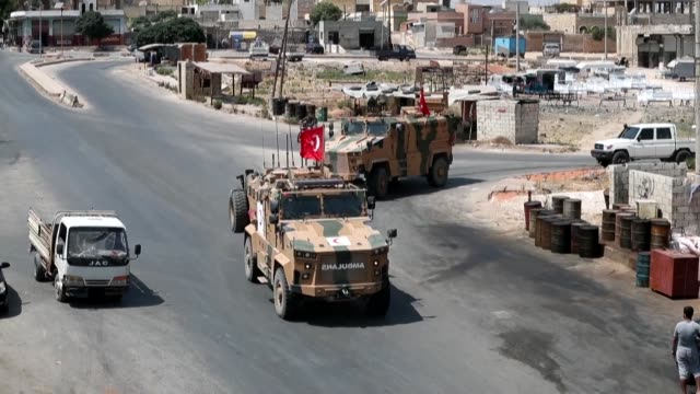 vídeos de stock, filmes e b-roll de turkish army convoy passing on a road in saraqib a town in in the northwestern idlib province - army