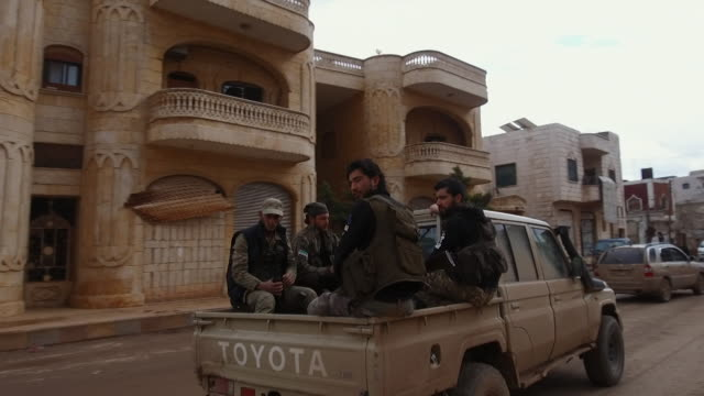 turkish backed forces and armed jihadists in truck on the way to the frontline as fighting continues in idlib, syria - jihad stock videos & royalty-free footage