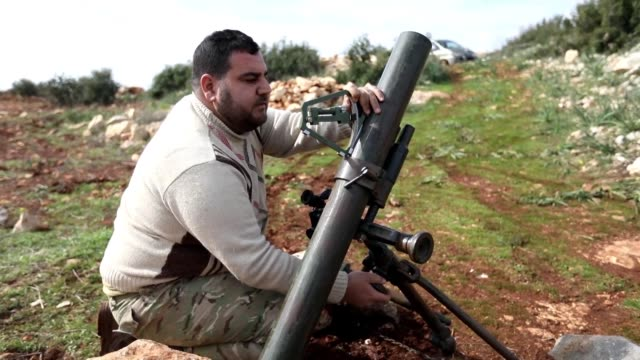 Turkish backed Syrian rebel fighters fired from the area of Salwah a town near the Turkish Syrian border towards positions of the Kurdish forces in...