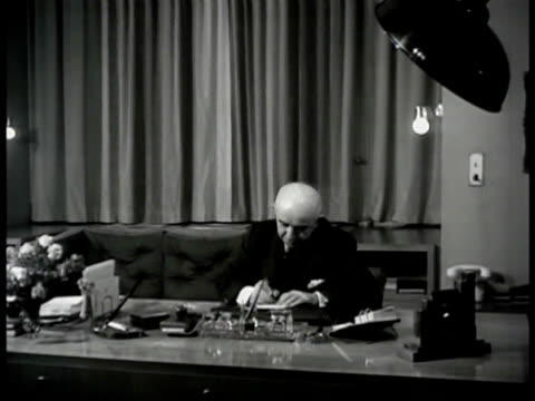 vídeos de stock e filmes b-roll de turkish building int ms turkey president ismet inonu at desk ms inonu writing cu note pad vs prime minister mehmet r peker talking to council anakara - 1947