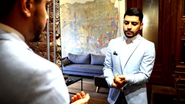 turkish business man in front of the mirror - cravat stock videos and b-roll footage