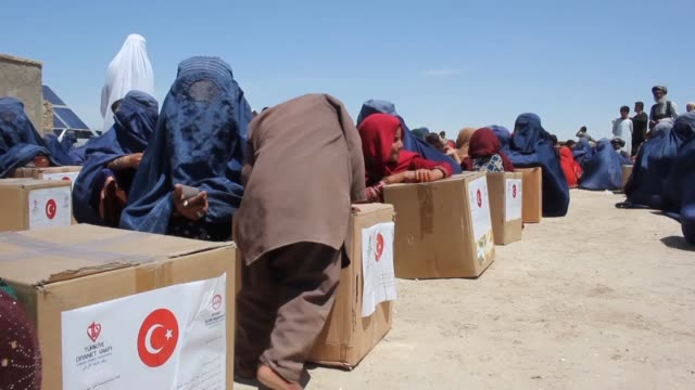 turkish charity organization turkiye diyanet foundation distributes food packages to 800 families at hazrat bilal internally displaced people camp as... - afghanistan stock videos & royalty-free footage