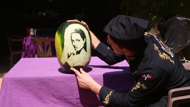 Turkish chef Halil Bozkurt carves portraits of worldfamous people on watermelons in southern Hatay province of Turkey on August 17 2018
