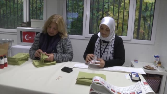 turkish citizens cast their ballots for turkey's upcoming parliamentary elections at turkish embassy in berlin germany on october 8 2015 snap... - wahlurne stock-videos und b-roll-filmmaterial