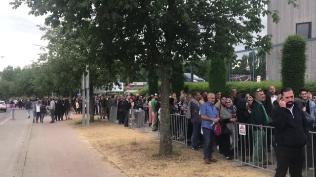 Turkish citizens living in Belgium wait in line to cast their ballots for Turkey's presidential and general elections at a polling station in...