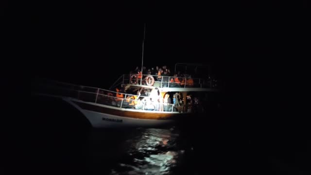 turkish coast guard members conduct a rescue operation for refugees whose boat capsized in the aegean sea while they were trying to reach greece... - capsizing stock videos & royalty-free footage