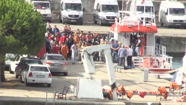 Turkish Coast Guard members evacuate injured migrants from a rescue boat at Kefken port during a rescue operation in Kandira district of Kocaeli...