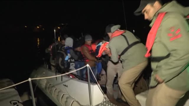 turkish coast guard members rescue syrian refugees whose boats were taking on water due to a leak while they were illegally trying to reach greece's... - mediterranean turkey stock videos and b-roll footage