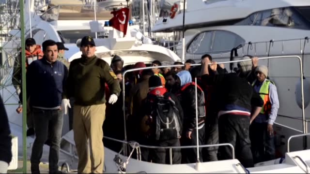 turkish coast guards rescue the migrants after they were stuck on gorecek island following the capsizing of a migrant boat allegedly carrying illegal... - capsizing stock videos and b-roll footage
