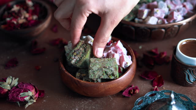 turkish coffee and turkish delight lokum - taking turkish delight from bowl - turkish ethnicity stock videos & royalty-free footage