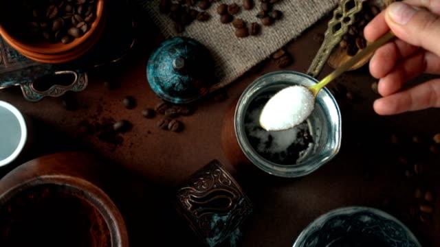 turkish coffee preparation and presentation (top view) - adding sugar - ottoman stock videos & royalty-free footage