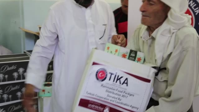 turkish cooperation and coordination agency delivers food aid to palestinians at zakat committee center in east jerusalem during muslim's holy... - east jerusalem stock videos & royalty-free footage