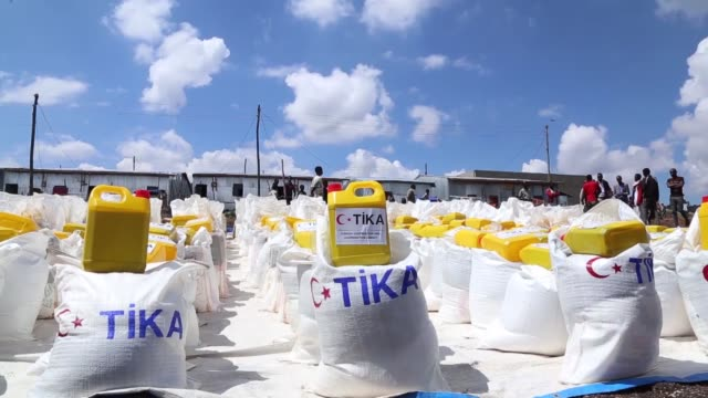 turkish cooperation and coordination agency distributes food to 800 families during the muslim holy fasting month of ramadan on may 24, 2019 in gelan... - ethiopia stock videos & royalty-free footage