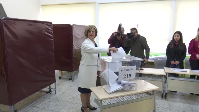 Turkish Cypriot leader Mustafa Akinci casts his ballot for the snap general elections at a polling station in Lefkosa on January 07 2018 Voters in...