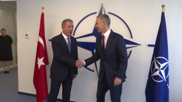 turkish defence minister hulusi akar meets nato secretary general jens stoltenberg on the sidelines of nato defense ministers' meeting in brussels... - nato stock videos & royalty-free footage