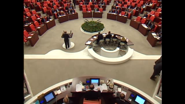 turkish defense minister fikri isik delivers a speech at the grand national assembly of turkey after parliament approved a motion to extend turkish... - 12 13 years stock videos & royalty-free footage