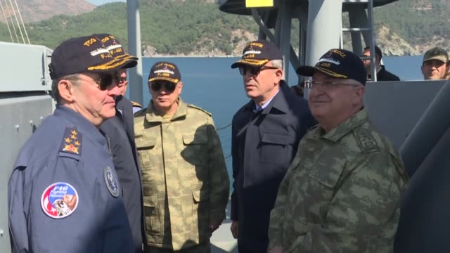 turkish defense minister hulusi akar chief of general staff yasar guler naval forces commander adnan ozbal land forces commander gen umit dundar and... - mugla province stock videos and b-roll footage