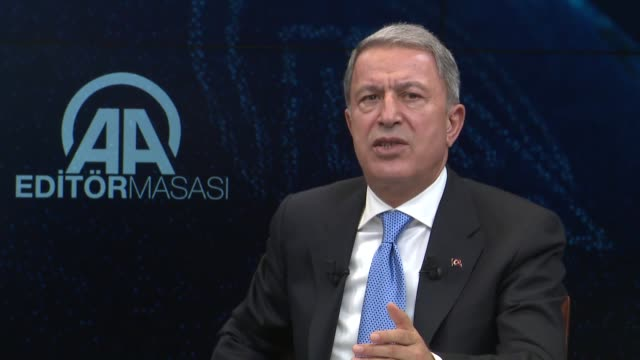 turkish defense minister hulusi akar speaks at the anadolu agency's editor desk on october 24 2018 in akara turkey on the delivery of the us f35... - legal defense stock videos and b-roll footage