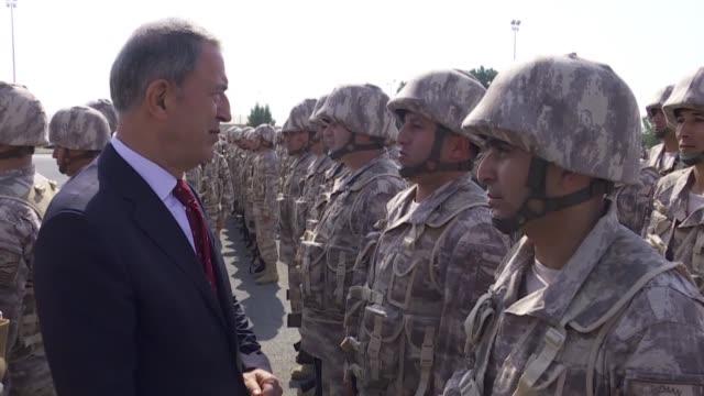 "stockvideo's en b-roll-footage met turkish defense minister hulusi akar speaks during his visit to turkish forces in doha, qatar on december 20, 2018. turkey is preparing ""intensely""... - leger krijgsmacht"