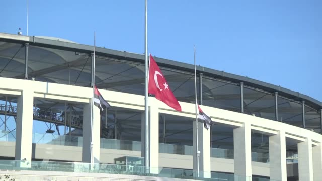turkish flag flies at halfmast is front of the vodafone arena as a sign of national mourning a day after two bomb attacks that killed at least 29... - besiktas stock videos and b-roll footage