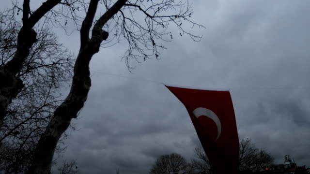 A Turkish flag is seen blowing in the wind outside the Kadikoy ferry terminal on February 16 2016 in Istanbul Turkey