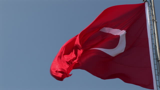 cu turkish flag waving in wind / istanbul, marmaris province, turkey - türkei stock-videos und b-roll-filmmaterial