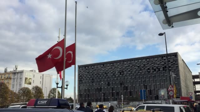 Turkish flags fly at halfmast at Taksim square in Istanbul on November 27 2017 to mark a day of mourning for the victims of Friday's deadly mosque...