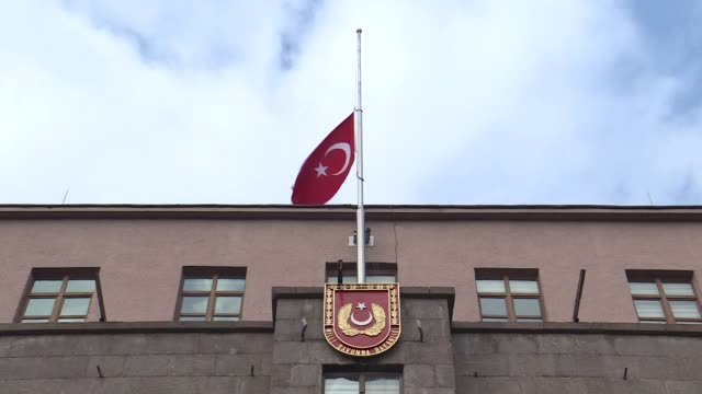 Turkish flags fly at halfmast on Turkish Interior Ministry and Defence Ministry buildings in Ankara on November 27 2017 to mark a day of mourning for...
