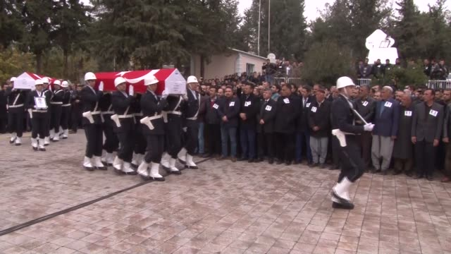 Turkish Food Agriculture and Livestock Minister Faruk Celik pays his condolences to the families of police officers Enes Cicek and Mehmet Tas who...