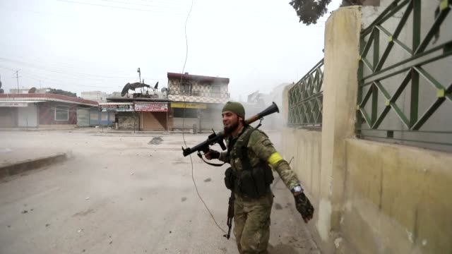 turkish forces and allied syrian rebels on thursday took control of the key northern town of jandairis from kurdish militia a monitor said - syria stock videos & royalty-free footage