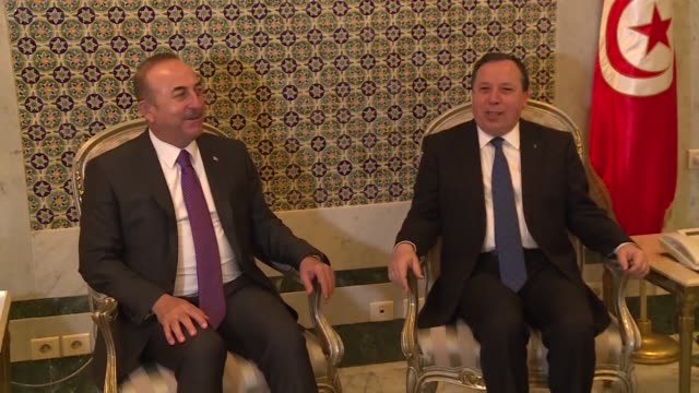Turkish Foreign affairs minister Mevlut Cavusoglu meets his Tunisian counterpart Khemaies Jhinaoui during his visit to Tunis where the two men...