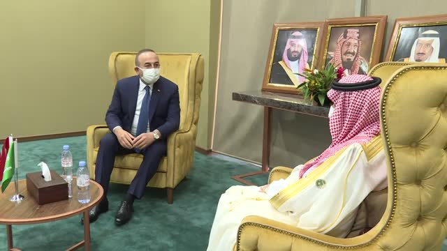 turkish foreign affairs minister mevlut cavusoglu meets with his saudi counterpart faisal bin farhan al saud on the sidelines of the 47th session of... - ニアメ点の映像素材/bロール