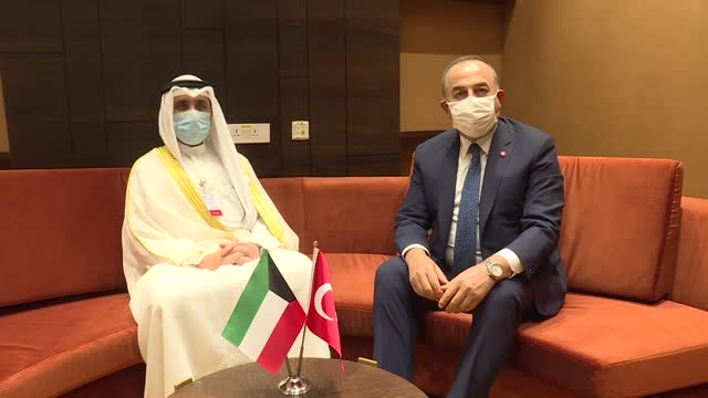 turkish foreign affairs minister mevlut cavusoglu meets with his kuwaiti counterpart sheikh dr. sheikh nasser al-mohammed al-ahmed al-jaber al-sabah... - ニアメ点の映像素材/bロール